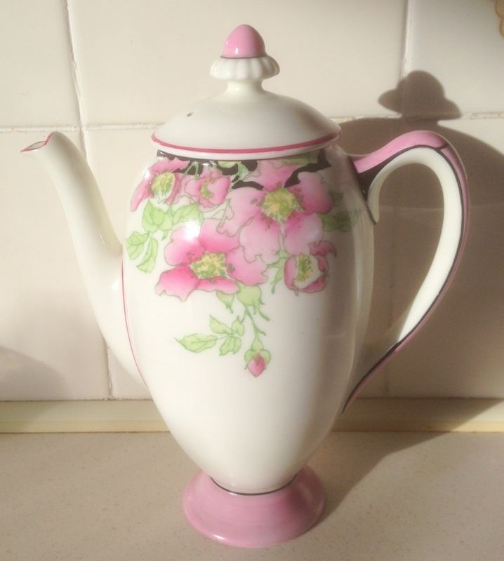 Doulton deco: Rosea coffee pot, V1486, c1933 (6). Pink colourway - pink flowers, green leaves and black shadows, with pink and black handle feature, light pink highlights and dark pink and black trim.