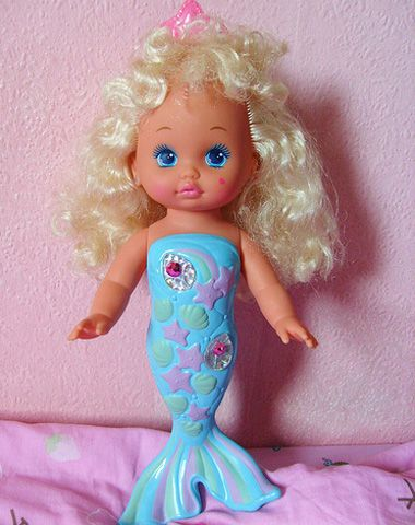 Mattel Lil' Miss Mermaid Doll (1991) Her tail would change color in warm water. I'm pretty sure we had her.