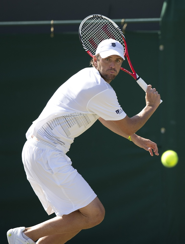 Mardy Fish in third round action of the 2012 Wimbledon Championships.  Fish will play his fourth season of World TeamTennis this summer with the Sacramento Capitals.