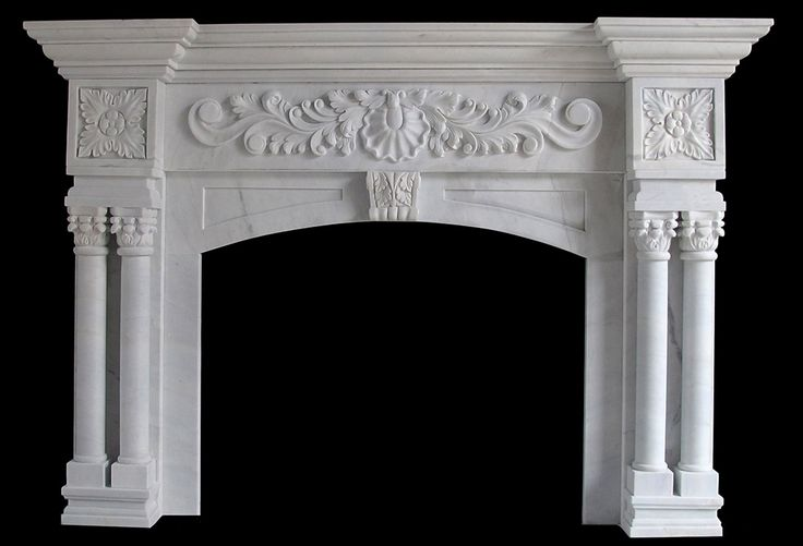 White Marble columns round tapered with decorative cap and base on a fireplace mantel Stone Fireplaces Chicago