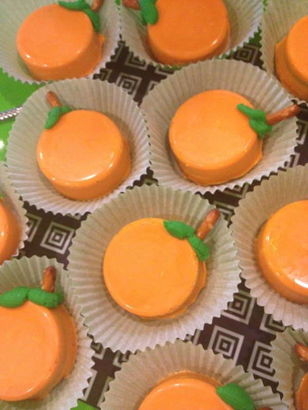 Chocolate Covered Oreos~White Chocolate dyed Orange and then Pipe some leaves on with Green Frosting and add a Pretzel for a Stem