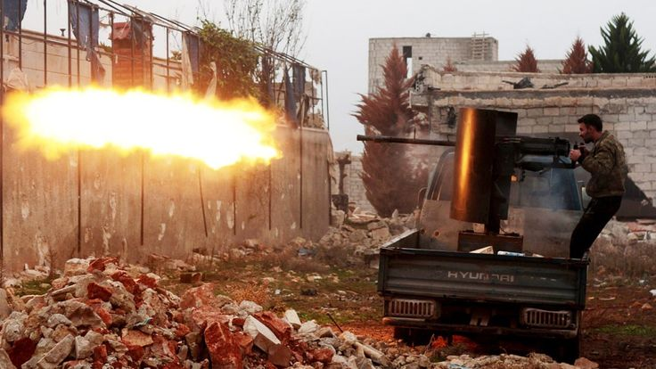 Islamic Front members attack Assad regime forces in Aleppo