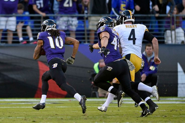 Steelers vs. Ravens:  21-14, Ravens  -  November 6, 2016  -   Baltimore Ravens wide receiver Chris Moore (10) runs in a blocked punt for a touchdown past Pittsburgh Steelers punter Jordan Berry (4) and  Ravens fullback Kyle Juszczyk, center, in the second half of an NFL football game, Sunday, Nov. 6, 2016, in Baltimore. (Credit: AP / Nick Wass