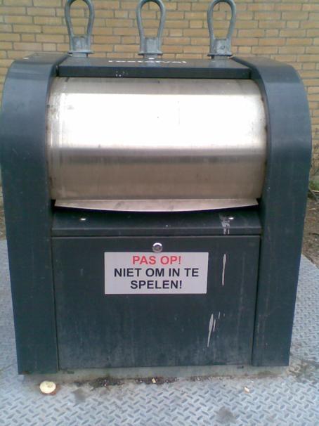 """""""Pas op! Niet om in te spelen!"""" means """"Beware! Not to play in!"""" Underground waste container, Capelle aan den IJssel, The Netherlands. Children who fit in can't read it..........."""