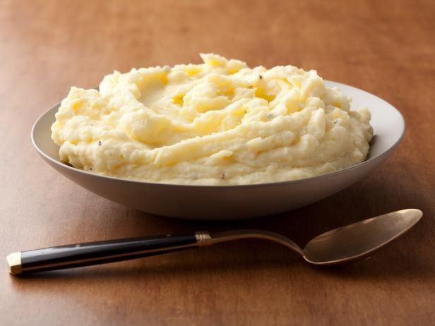 Barefoot Contessa's Sour Cream Mashed Potatoes : Ina uses Yukon Gold potatoes for this classic Thanksgiving side. Once mashed, a touch of sour cream adds richness.