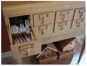 a card catalogue for kitchen utensils has enough compartments to store your knives, forks, spoons, serving utensils, napkins, and more