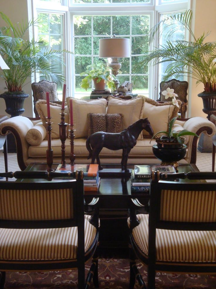 Nice looking sitting room with formal settings, antique accessories, oriental rug and nice large windows.