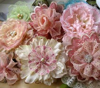 Sweetly vintage looking, shabby chic approved lace and eyelet rosettes. #flowers #roses #rosettes #crafts #lace #scrapbooking