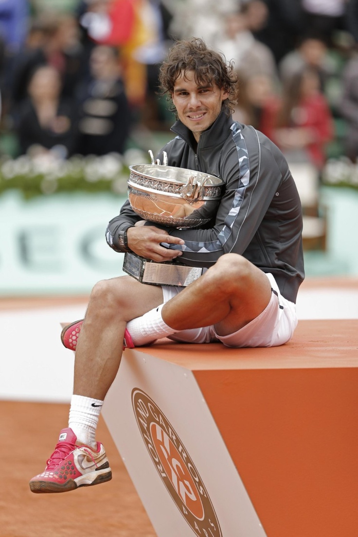 Image Detail for - Rafael Nadal of Spain poses with the trophy after winning the mens final match against Novak Djokovic of Serbia at the French Open tennis tournament in Roland Garros stadium in Paris, Monday June 11, 2012.