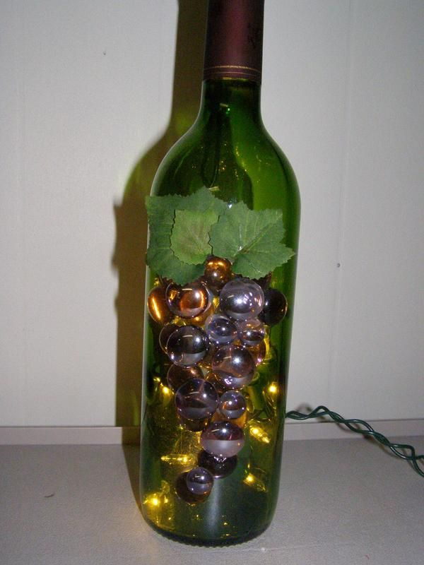 decorate wine bottles with marbles | Green Lighted Wine Bottle with Purple Marbles. This is made from a ...