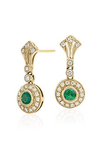 Inspired by vintage jewelry, these sophisticated 14k yellow gold earrings feature milgrain halos with pavé-set diamonds that frame beautiful emeralds.