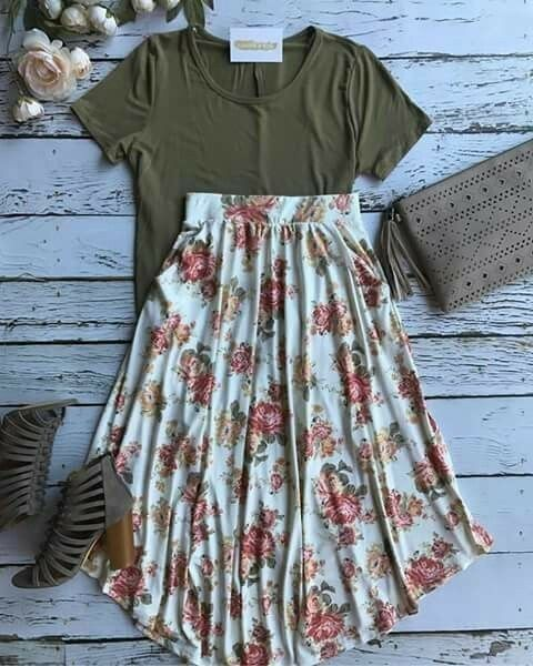 Casual Playful Daytime LookOlive Green T-Shirt, Fitted&Scoop Neck Line, High Waisted White Ivory A-Line Skirt w/Floral Print Shades of Pinks, Reds & Greens, Neutral Grey Accessories w/Chunk Heel Strappy Open Toed Sandals & Medium Sz Suede & Fringe Accent
