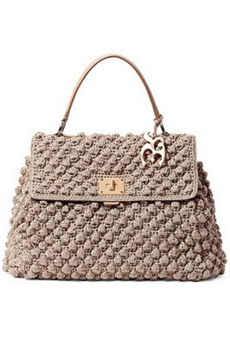 Beautiful crochet purses...not in English but image of the stitch that's used. Could try to figure it out.