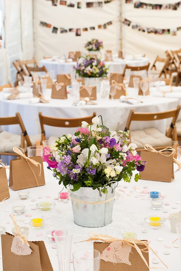 So much great detail from the favours & tags, to the coordinated chairs to the photos in the background.  Nikki & Alistair's Wedding at Lusty Glaze Beach, Newquay, Keith Riley Photography