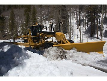 Cat | Cat® Motor Graders Reach New Heights in Snow Removal | Caterpillar