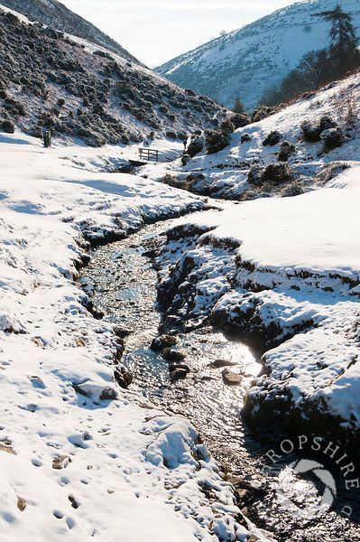 A layer of snow in Carding Mill Valley, near Church Stretton, Shropshire, England.