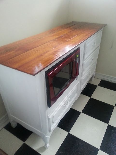 Side view of repurposed dresser into kitchen island. Great way to use space. Great place for the microwave.