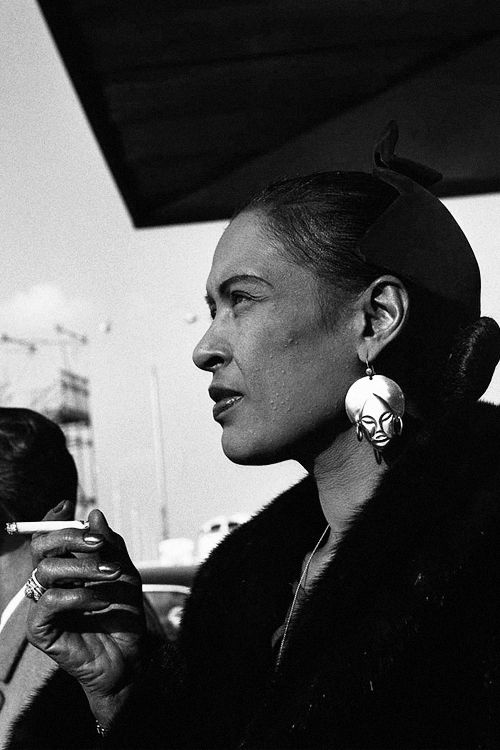 Billie Holiday at the d'Orly airport, Paris, photographed by Jean-Pierre Leloir, 1958.