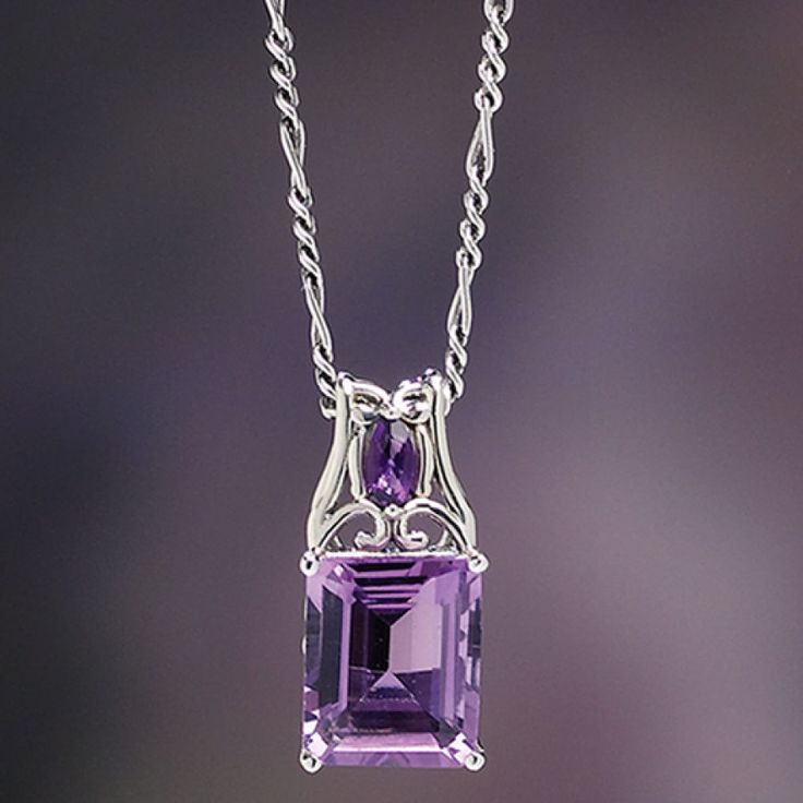 """Double Amethyst Pendant  Meditate on these: two genuine amethysts—one, a 3.55-ct., square-cut African amethyst, the other a faceted amethyst accent—soothe the wearer in this handsome pendant of fine sterling silver. 3/4"""" long."""