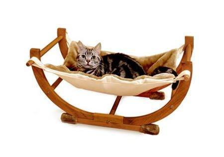 cat hammock, modern cat furniture. Pinned this to show how they used wooden dowels to hang the hammock on.