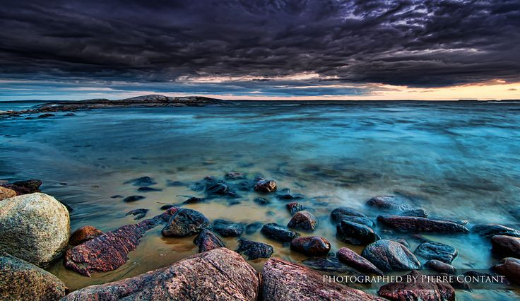 Sunset Beach - North Bay, Ontario, Canada The Calm Before The Storm by Pierre Contant