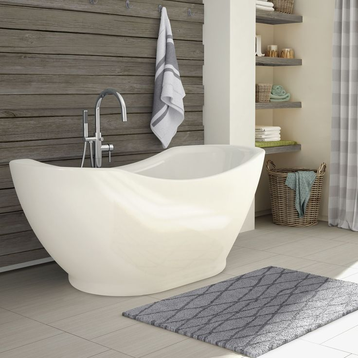 The sleek and modern lines of the Salacia free-standing bathtub will be a showpiece in your bathroom. This tub features symmetrical backrests and an integrated overflow with a matching faucet and handheld shower.