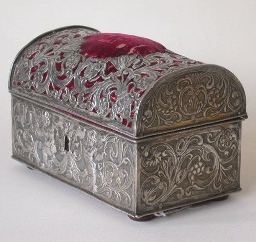 A French repoussead silver casket, part of a large toilet service. Marked with date letter for Paris 1643