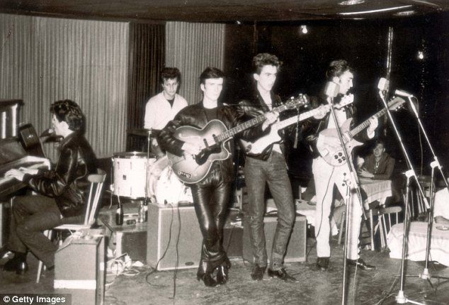 The Beatles, with Pete Best on drums and Stuart Sutcliffe on bass, performing together in Hamburg in 1960