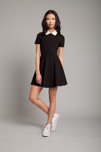 Be afraid, be very afraid…this dress will have others staring all night long. The Addams Mini Dress features a white turn down collar with short sleeves and a h