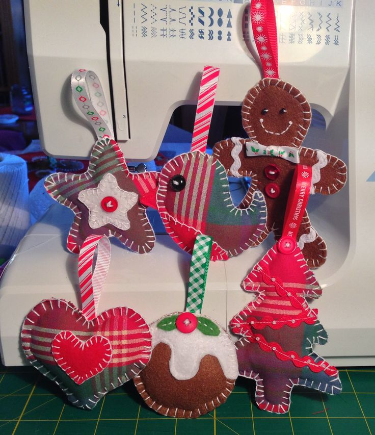 A selection of handmade christmas decorations by Oh Sew Maeve. Tartan and velvet appliqué.  https://www.facebook.com/pages/Oh-Sew-Maeve/1410531509175788?ref=hl