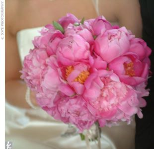 Elizabeth's raspberry and silver hues were reflected in her bouquet of raspberry peonies tied with silver satin ribbon.