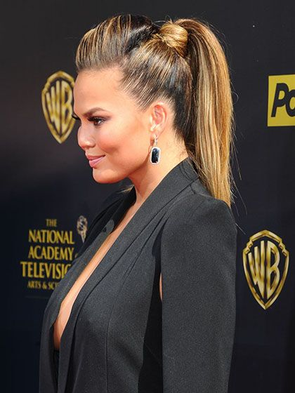 Summer Ponytail Hairstyle: Chrissy Teigen sleek, voluminous high pony with a pouf. Finish off with hair wrapped around the elastic