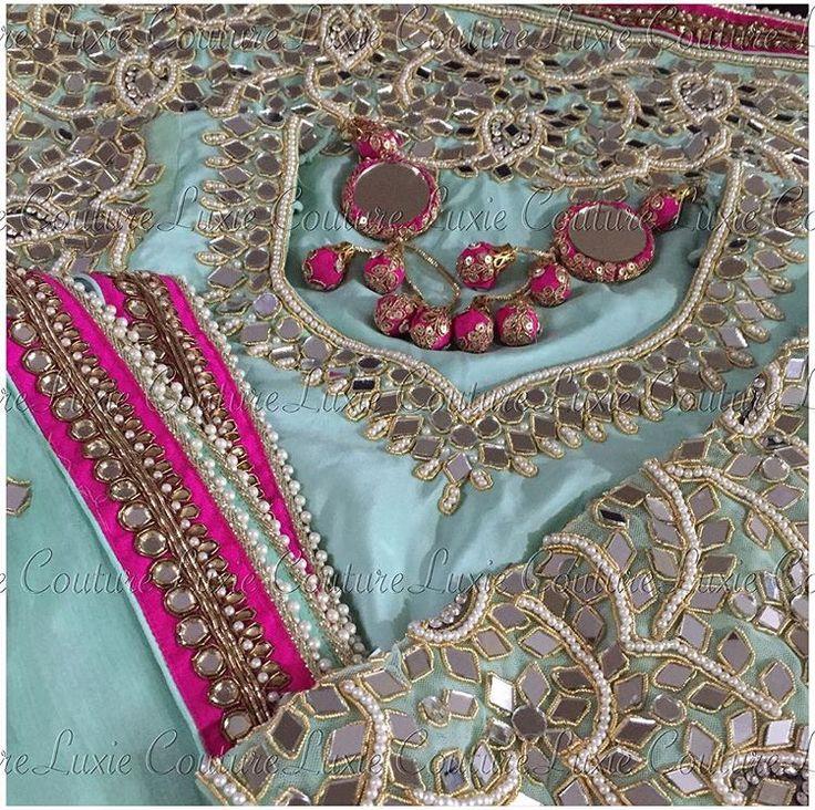 Gorgeous mirror detailing on this Luxie Couture ensemble.