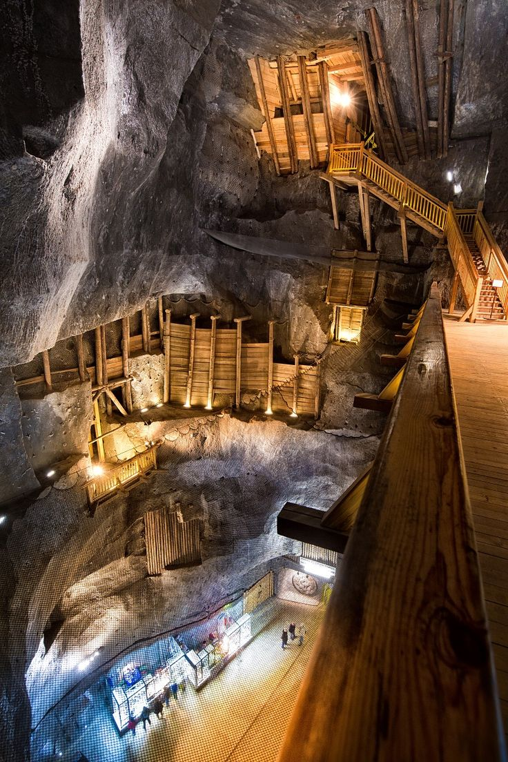 """The captivating interior of the """"Wieliczka"""" Salt Mine is a perfect setting for organising a training session, a ball, a press conference or an unforgettable wedding. wieliczka, salt, mine, poland, krakow, Cracow,  cave, church, arch, sculpture, bar, vault, rock, statue, archaeology, arc, column, surrounding, deep, history, windlass, winch, ceiling, cable, depth, old, stage, wood, wall, chambers, underground, barrel, longitudinal, crystal, salty, shaft, art, museum"""