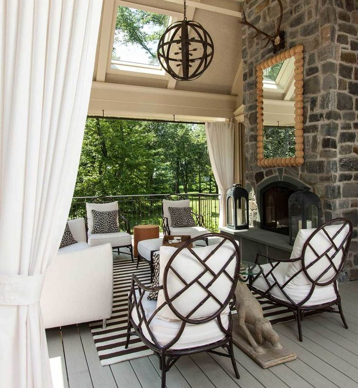 From the stone fireplace to the lighting and draperies this is a beautiful and inviting outdoor space.