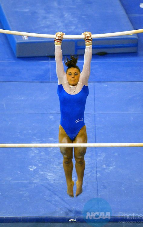 26 APR 2003:  Jamie Dantzscher of UCLA competes in the uneven bars during the Division 1 Women's Individual Gymnastics Championship held at the Bob Devaney Sports Center on the University of Nebraska campus in Lincoln, NE.  Dantzscher tied for first in the event with a 9.900 score.  Scott Bruhn/NCAA Photos