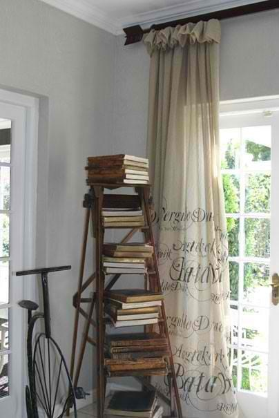 What's trending now... old ladders. What a great way to display books. City Farmhouse in Franklin has several ladders including the hard to find orchard ladders.