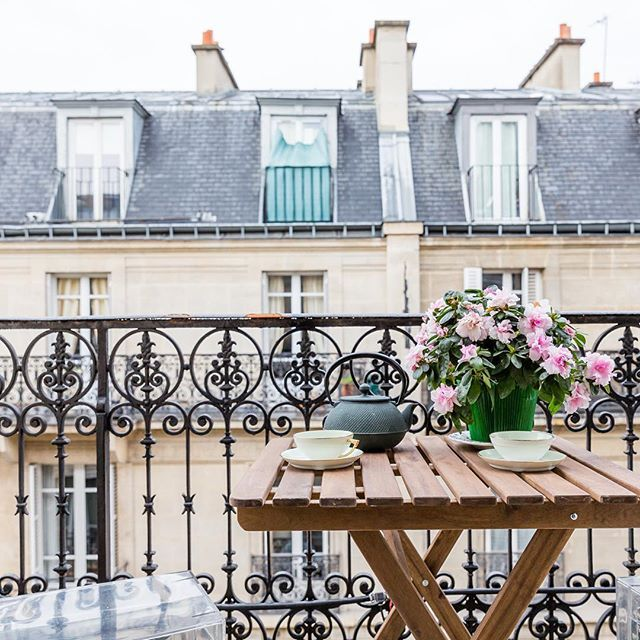 """Dine Al Fresco - """"The streets of the City of Lights are lined with the quintessential Parisian Haussmann architecture: buildings lined with wrought-iron balconied windows, and garrett windows on the top floor,"""" says the onefinestay team. """"Any apartment or home with an outdoor space available is perfect for a simple table and chair where one can enjoy coffee to sip while you watch the city down below."""" While you might not have as much people-watching to do if you live in, say, a sleepy street…"""