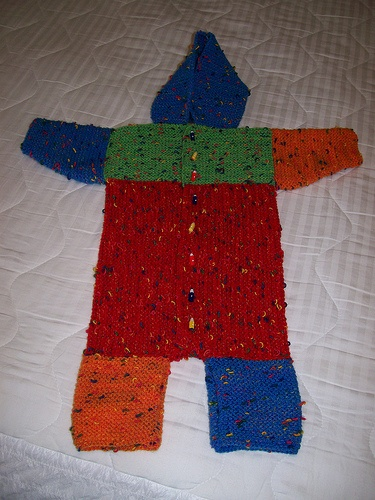 Baby Albert Bunting from Sally Melville's Knitting Experience --- Just finished knitting this for my new grandson. Differences on mine are the body is orange, yoke is yellow, sleeves are teal, legs are lime green, and hood is red. I used 100% cotton yarn. Now I just need to decide on buttons for it.
