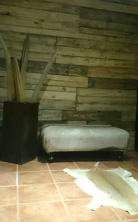 The result of wall covered with storage pallet planks,lightly sanded...