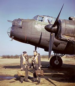Aircrew in front of a Lancaster B.II with Hercules engines.