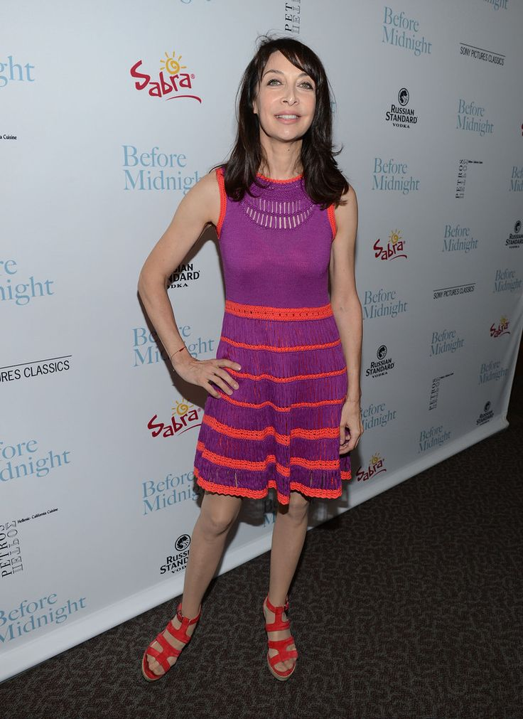 Illeana Douglas Cocktail Dress - Illeana Douglas opted for bold and fun colors when she wore this purple crocheted dress that featured orange trim and stripes.