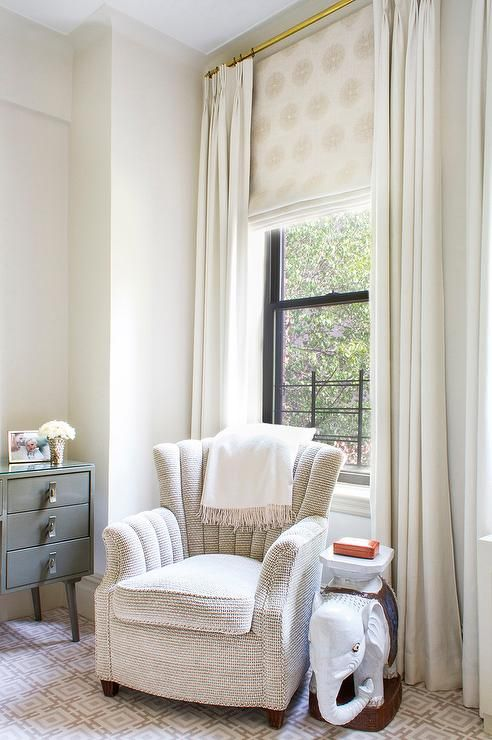 Chic Bedroom Boasts An Upholstered Art Deco Chair And An Elephant Side  Table Placed Under A Part 96