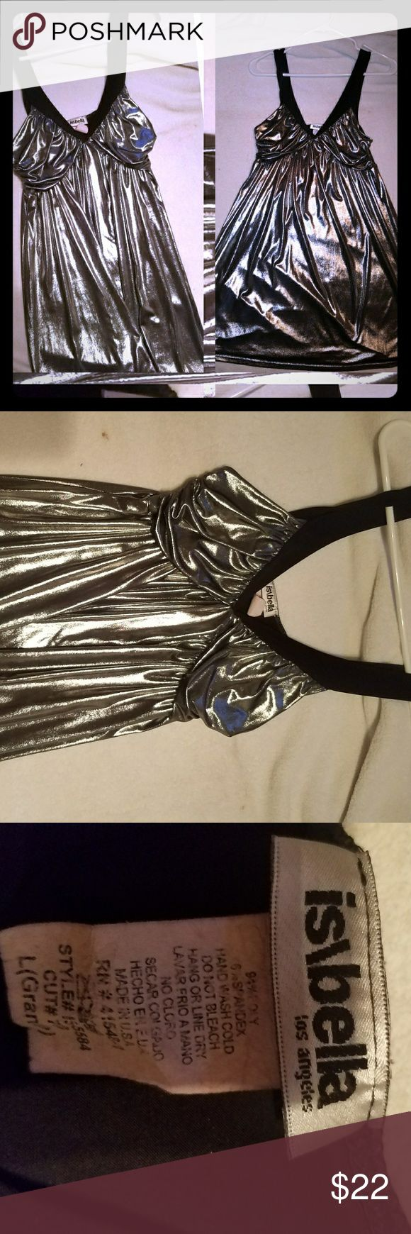 Mini Short Metallic Silver Summer Dress Size Large This is a one-of-a-kind dress that I bought in a small boutique in Los Angeles . It's a metallic short mini summer dress ...Very flowy, very lightweight , very comfortable,and  elegant fun dress. It's a very versatile  you could wear it to the beach with flip flops on or dress it up with a nice high heel and go to a club or a nice dinner it's a perfect piece to have while traveling . Dresses Mini