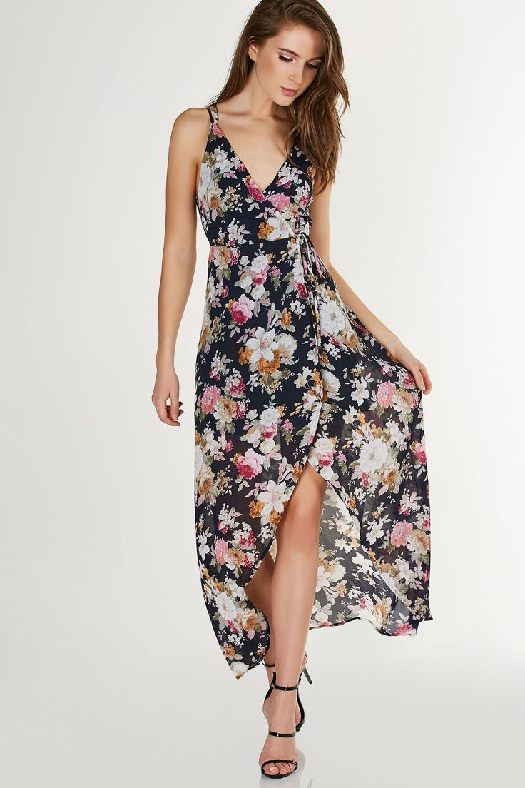 Gorgeous printed hi-low dress with wrap front closure. Strappy design with intricate floral patterns throughout.