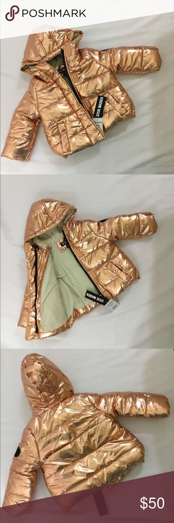 STEVE MADDEN Shiny Cire Puffer Jacket (baby girls) Adorable STEVE MADDEN rose gold baby puffer coat.  *Size 12 months.  *Attached hood with faux fur lining.  *Metallic *Long sleeves with banded cuffs.  *Zip front closure and 2 front slip pockets. *Quilted puffy design.  *Fleece lined.  *Shell/Lining/Fill/Faux Fur: 100% polyester. Steve Madden Jackets & Coats Puffers #babygirlcoats