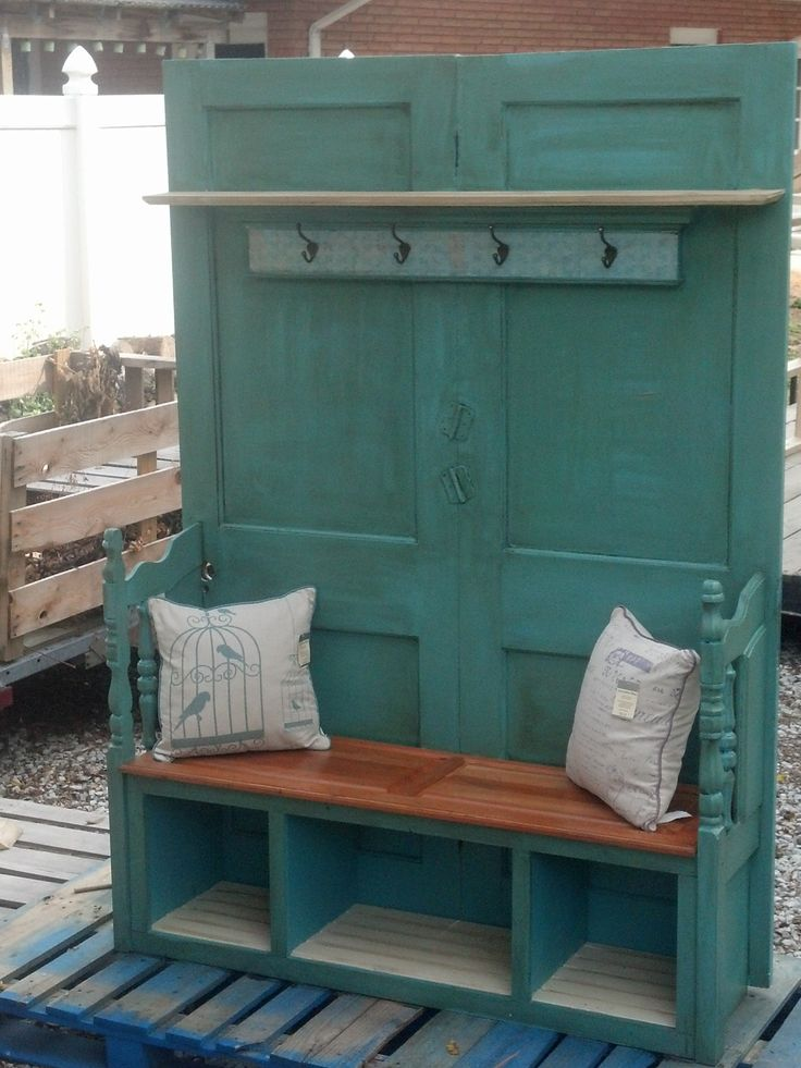 Up-cycled Hall Tree: Made from salvaged doors, door headers.  Perfect to place by front door for coats. Built in cubbies for shoes.