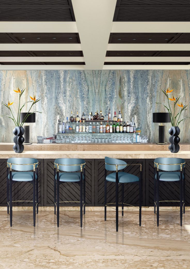 Try not to get handsy with the flirty and modern design of the Nahéma bar or counter stool. Her sweet seat and contemporary detached back are bound by a metal and lacquer frame complete with two hand details, insistently grasping at your desire.