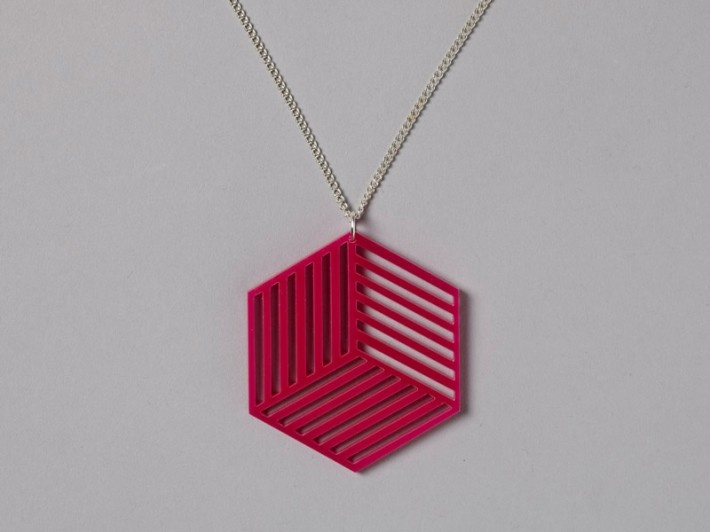 Lianna Sheppard Cube Necklace from her Ocular Jewellery collection. Laser cut acrylic jewellery based around the concept of optical illusions.    Colour: Pink / Pendant size: 5 x 5.7 cm / 3mm thick acrylic / All necklaces come on 22″ silver plated chains.  Available to buy now at newfoundoriginal.com