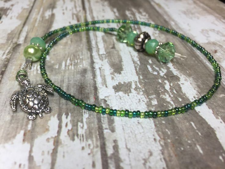 """Mark your place in a good book with this gorgeous beaded turtle bookmark. A great gift for any reader! This beaded bookmark will have everyone asking, """"Where did you get that?"""" This beaded bookmark wi"""